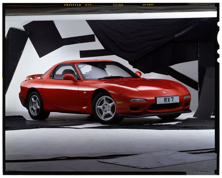 unedited studio image showing a large format sheet of film with Mazda RX7